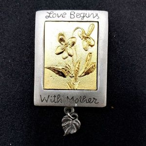 1999 Marjolein Bastin Love Begins With Mother Pin